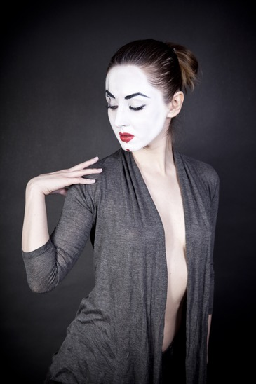 female mime on  black background