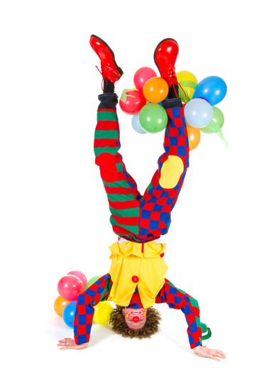Funny clown in headstand